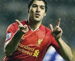 Luis Suarez celebrates his goal which completed Liverpool's 4-0 hammering of Everton at Anfield last night