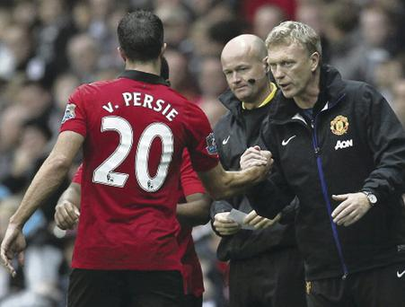 Job done: van Persie is congratulated by David Moyes as he is taken off against Swansea