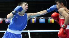 Full stretch: Michael Conlan lands a stunning left hand on Shiva Thapa en route to his victory on points