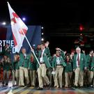 Competitors from Northern Ireland arrive, with flag bearer Martin Irvine during the 2014 Commonwealth Games Opening Ceremony at Celtic Park, Glasgow