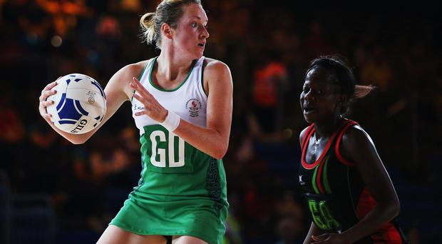 GLASGOW, SCOTLAND - JULY 24: Nordia Masters of Northern Ireland looks to pass the ball during the Preliminary Round Group A match between Malawai and Northern Ireland at SECC Precinct during day one of the Glasgow 2014 Commonwealth Games on July 24, 2014 in Glasgow, United Kingdom. (Photo by Hannah Peters/Getty Images)