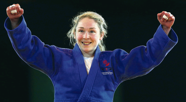 Lisa Kearney of Northern Ireland celebrates winning Bronze in the Womens -52kg Bronze medal contest against Kalpana Thoudam of India at SECC Precinct during day one of the Glasgow 2014 Commonwealth Games on July 24, 2014 in Glasgow, Scotland. (Photo by Hannah Peters/Getty Images)