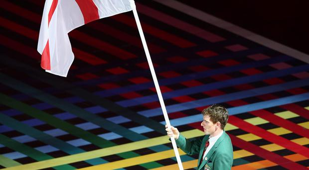 GLASGOW, SCOTLAND - JULY 23: Flag bearer and Cyclist Martyn Irvine of Northern Ireland during the Opening Ceremony for the Glasgow 2014 Commonwealth Games at Celtic Park on July 23, 2014 in Glasgow, Scotland. (Photo by Paul Gilham/Getty Images)