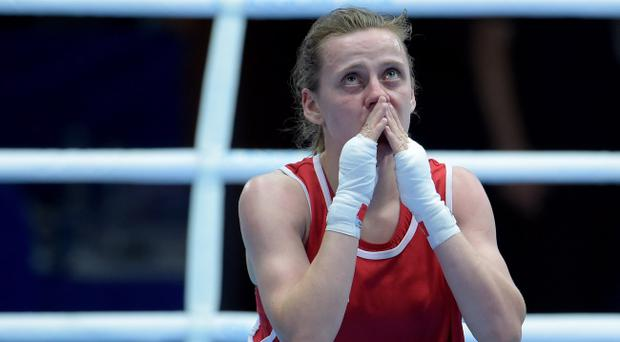 Michaela Walsh enjoys the moment after beating her Mauritian opponent Thessa Dumas in the Commonwealth Games' first-ever women's boxing bout