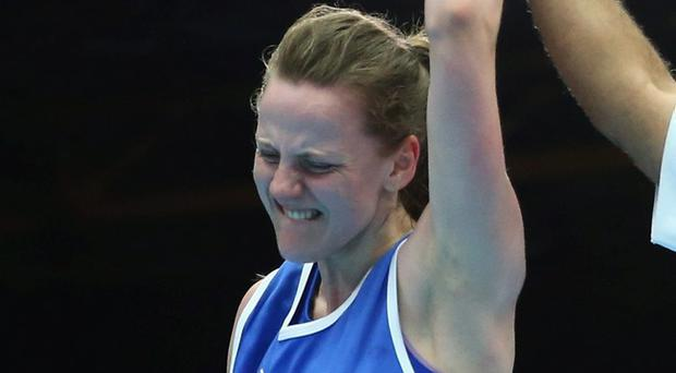 Michaela Walsh of Northern Ireland celebrates after defeating Sarah Joy Rae of Jamaica in the Women's Fly 48-51kg Division