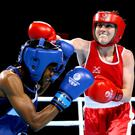 Punching power: Michaela Walsh lands a blow on Nicola Adams