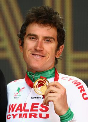 Geraint Thomas of Wales celebrates with his gold medal after the Men's Cycling Road Race in the Glasgow 2014 Commonwealth Games