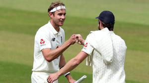 Stuart Broad, left, is the seventh player in history to take 500 Test wickets (Martin Rickett/PA)