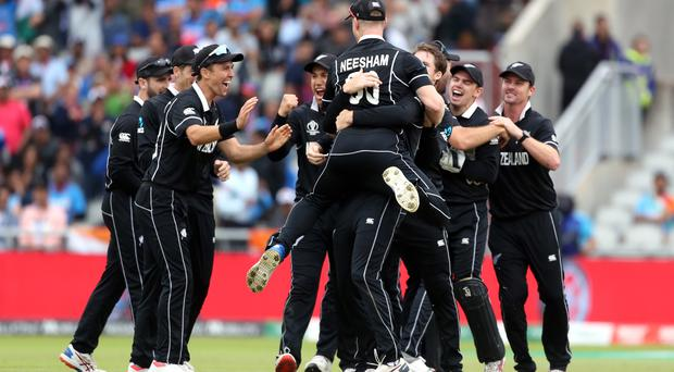 New Zealand players celebrate after India's MS Dhoni is run out during the ICC World Cup, Semi Final at Old Trafford, Manchester.