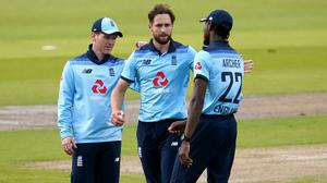 Chris Woakes (centre) says centrally-contracted players will feel impact after job cuts were announced (Jon Super/PA)