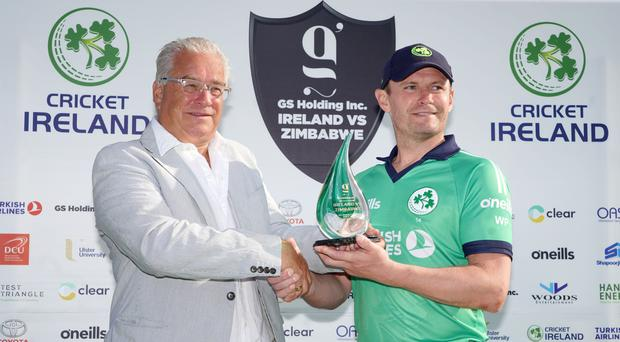 Success story: William Porterfield receives the Series Trophy from Cricket Ireland Chairman, Ross McCollum