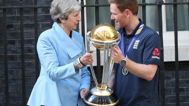 Theresa May with England cricket captain Eoin Morgan outside Downing Street, London, to celebrate England's victory in the ICC World Cup (Yui Mok/PA)