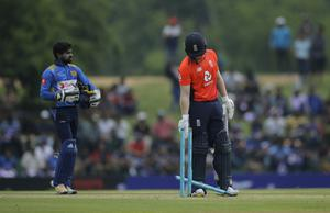 Eoin Morgan expressed his frustration at the game with Sri Lanka being rained off (Eranga Jayawardena/AP)