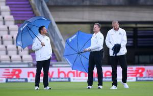 Umpires Richard Kettleborough, Martin Saggers and Michael Gough (left-right) inspect the pitch on day five of the second Test (Stu Forster/PA).