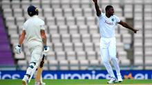 Captain's fall: West Indies captain Jason Holder (right) celebrates taking the wicket of England counterpart Ben Stokes at the Ageas Bowl