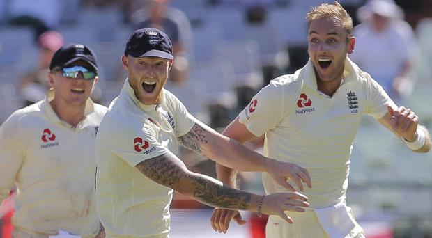 Ben Stokes, centre, and Joe Root celebrate in Cape Town (Halden Krog/AP)