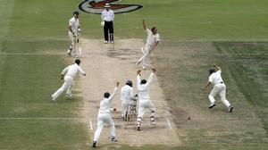 Australia players celebrate after Shane Warne takes the wicket of Monty Panesar to seal a 206-run win over England and reclaim the Ashes (Gareth Copley/PA)