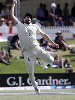 England's Dom Sibley celebrates after taking a catch to dismiss New Zealand's Colin de Grandhomme (Mark Baker/AP)