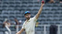 Mark Wood acknowledges the crowd after completing his five-wicket haul (Themba Hadebe/AP)
