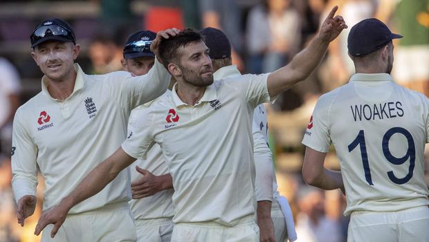 Mark Wood (centre) enjoyed a day to remember in Johannesburg (Themba Hadebe/AP).