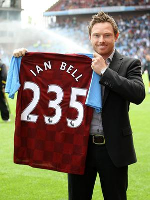 Ian Bell, an Aston Villa fan, holds up a club shirt signifying his 235 runs against India (Nick Potts/PA)