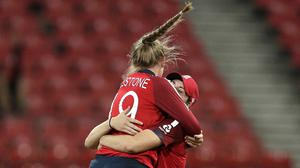 England's Sophie Ecclestone, left, jumps into the arms of team-mate Nat Sciver after they combined to take the wicket of West Indies' Deandra Dottin during their Women's T20 World Cup cricket match in Sydney (AP/Rick Rycroft)