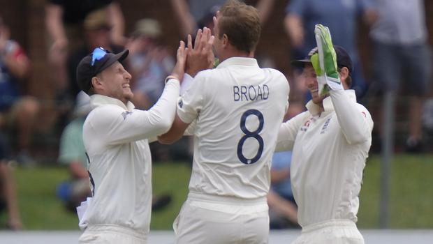 England's wicketkeeper Jos Buttler, right, Stuart Board, centre, and Joe Root celebrate the wicket of South Africa's Vernon Philander en route to clinching a fourth Test win over South Africa in Port Elizabeth (AP/Michael Sheehan).
