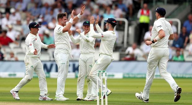 Mark Adair (second left) celebrates en route to helping Ireland bowl out England for just 85 at Lord's (Bradley Collyer/PA)