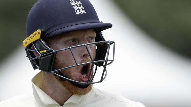 England's Ben Stokes reacts as he leaves the field after he was dismissed for 91 (Mark Baker/AP)