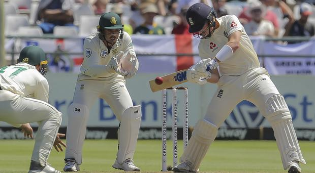 Ollie Pope scored a half-century for England but South Africa had the tourists nine down at the close (Halden Krog/AP)
