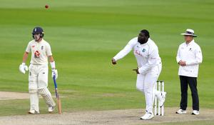 West Indies' Rahkeem Cornwall bowls during day one (Michael Steele/PA)