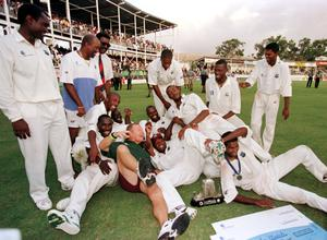 The West Indies celebrate their 3-1 series win against England in 1994 (Rebecca Naden/PA)