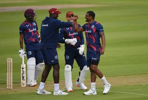 Shannon Gabriel (right) celebrates taking the wicket of John Campbell (Gareth Copley/PA).