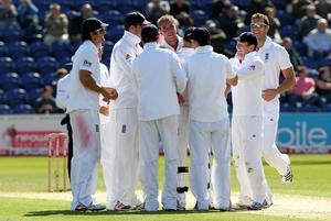 Stuart Broad (centre) is congratulated after dismissing Sri Lanka's Thisara Perera for his 100th wicket in Test cricket in 2011 (David Davies/PA)