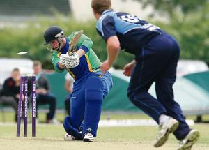 North West Warriors Ricky Lee Dougherty bowled out by Barry McCarthy of Leinster