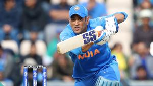 Mahendra Singh Dhoni donned gloves featuring a white insignia associated with the army (Adam Davy/PA)