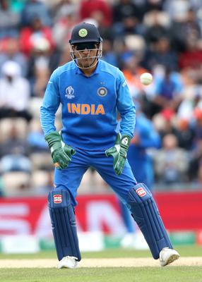 Mahendra Singh Dhoni wore the gloves against South Africa during India's opening match (Adam Davy/PA)