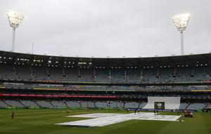 Playing in an empty ground could provide value to cricket fans watching on TV, says Justin Langer (Jason O'Brien/PA)
