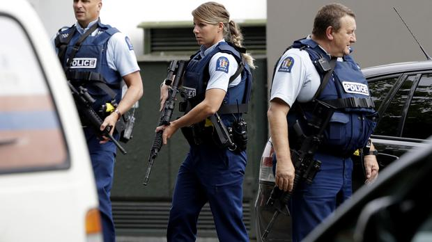 Armed police patrol outside a mosque in central Christchurch, New Zealand (Mark Baker/AP)