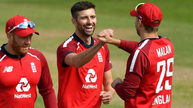 Mark Wood (centre) is happy to keeping proving himself in England's T20 side (Dan Mullan/PA)