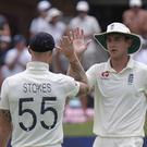Ben Stokes, left, and Stuart Board celebrate victory at Port Elizabeth (AP)