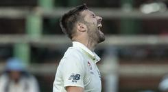 England's bowler Mark Wood celebrates after dismissing South Africa's batsman Anrich Nortje (Themba Hadebe/AP)