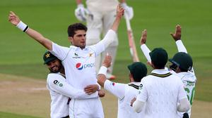 Pakistan's Shaheen Afridi celebrates with his team-mates after taking the wicket of England's Rory Burns (Stu Forster/PA)