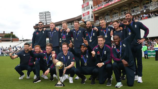 Chris Woakes, Eoin Morgan and the rest of the England team celebrate their World Cup win (Steven Paston/PA).