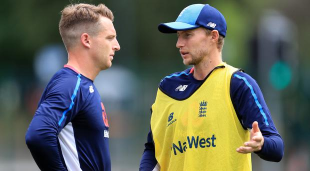 England's Joe Root, right, and Jos Buttler are not feeling well (Mike Egerton/PA)