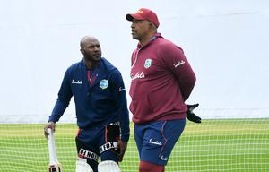 Blackwood, left, takes heart from the support of West Indies coach Phil Simmons (Gareth Copley/PA)