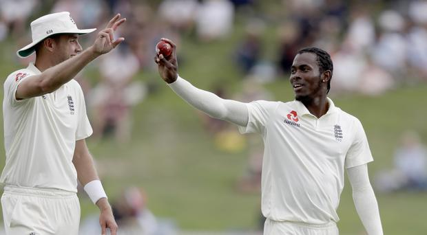 England's Jofra Archer and teammate Stuart Broad (Mark Baker/AP)