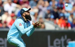 Moeen Ali catches Sri Lanka's Kusal Perera during England's Cricket World Cup group stage match at Headingley.