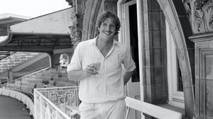 Ian Botham celebrated with a drink and a cigarette after taking eight wickets for 34 against Pakistan (PA)