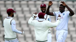 West Indies captain Jason Holder, right, celebrates taking England counterpart Ben Stokes' wicket (Mike Hewitt/NMC Pool/PA)